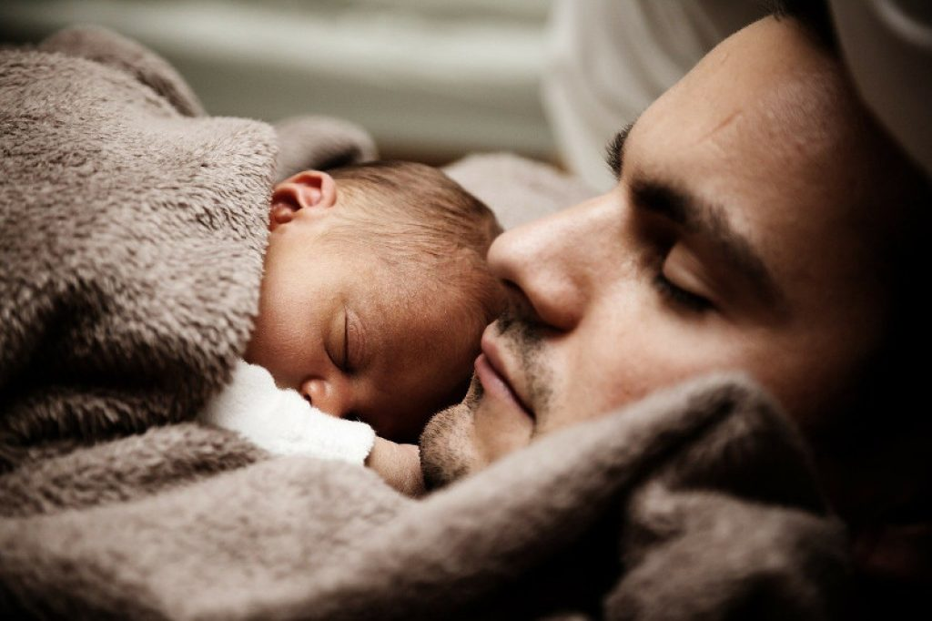 Father and child sleeping soundly